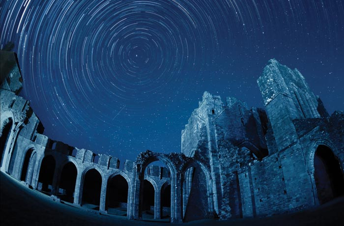 Llanthony Priory at Brecon Beacons International Dark Sky Reserve, Wales  (Photo by Michael Sinclair)