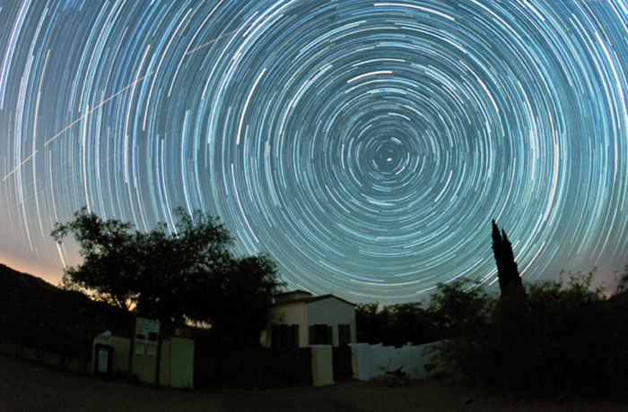 Star trails over the Kannally Ranch House at Oracle State Park, Arizona. Photo by Mike Weasner.