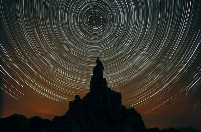 Star trails over the Wasserkuppe at Rhön International Dark Sky Reserve, Germany (Photo by Werner Klug)