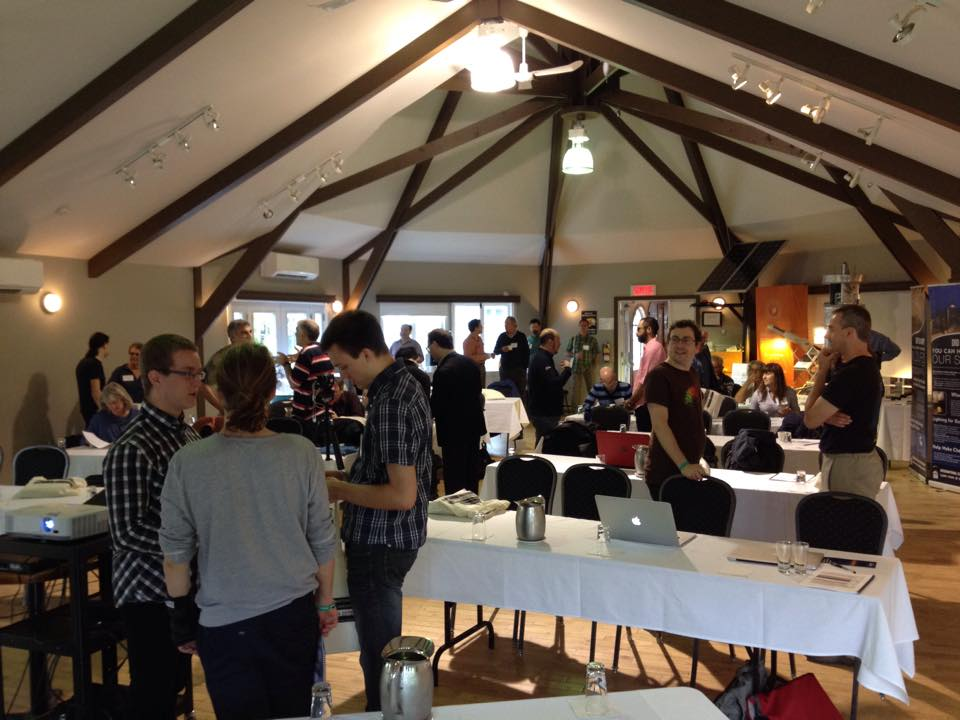 Conference Attendees Gather and Talk Before the Meeting Starts