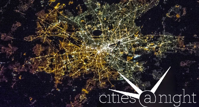 NASA nighttime satellite photo of East and West Berlin, Germany, showing the difference in lighting.