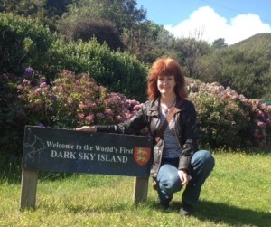A picture of Ada next to the Isle of Sark sign.