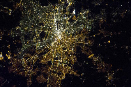 A satellite image of Berlin at night showing the differnce between the lights of west and east Berlin.