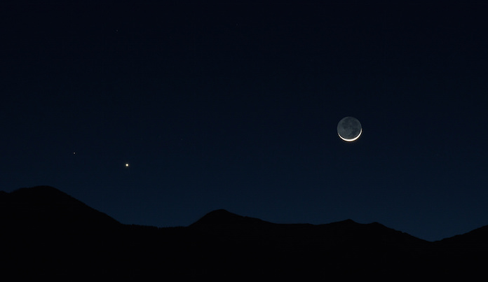 The Moon and Venus setting over the San Francisco Peaks, taken from Flagstaff, Arizona, an International Dark Sky Community.