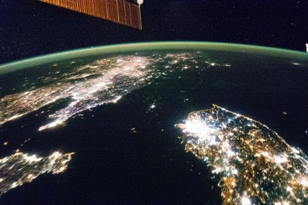Satellite image of North and South Korea, showing the stark difference in their lighting.