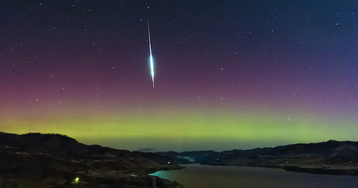 A fireball from the Taurids meteor shower against the Northern Lights near Keller, Washington.