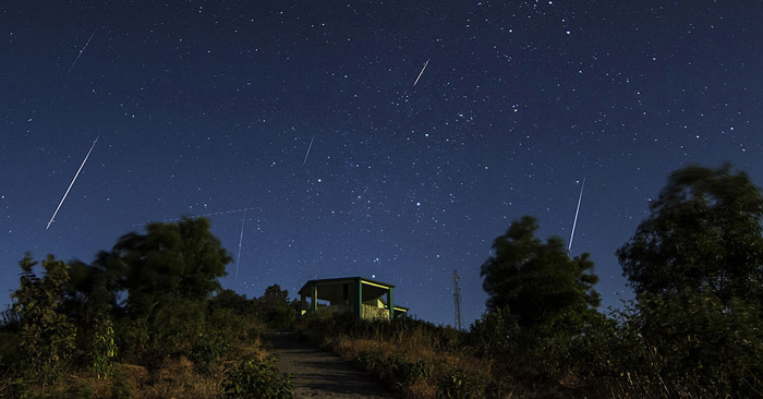 White streaks across a night sky are from the 2013 Geminid Meteor Showers.