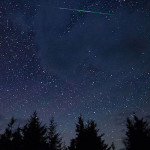 A meteor streaks across the sky during the annual Perseid meteor shower in 2015.