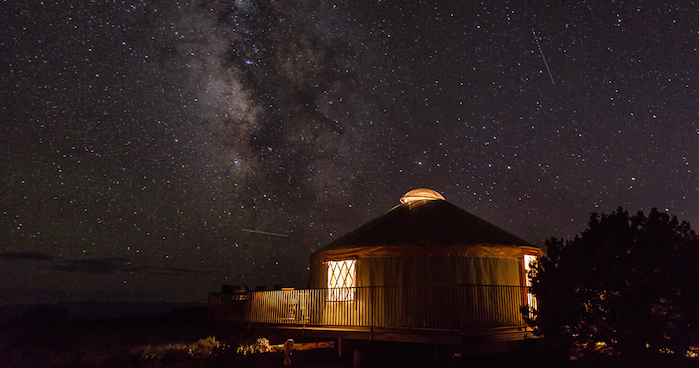 The Milky Way is shown in the sky above a yurt at Dead Horse Point State Park near Moab, Utah. Photo credit: Bret Edge.