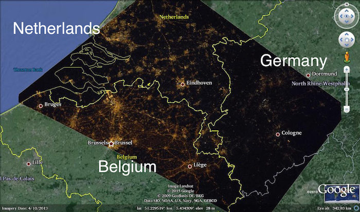 A satellite image showing border of The Netherlands, Belgium, and Germany at night, overlaid on a regional map. Image from an International Astronomical Union press release.