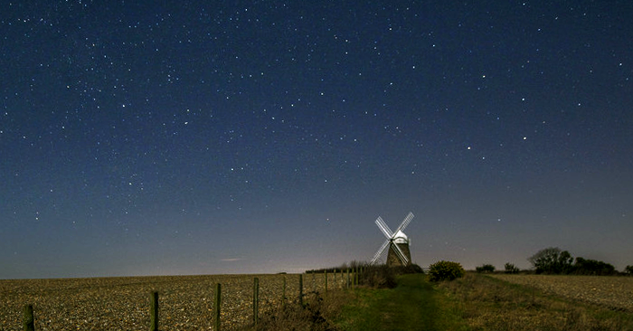 The eighteenth century Halnaker Windmill lit by moonlight. Photo by South Downs National Park Authority.
