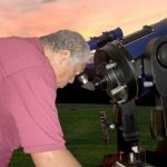 IDA Advocate Michael Lewis looking through a telescope.