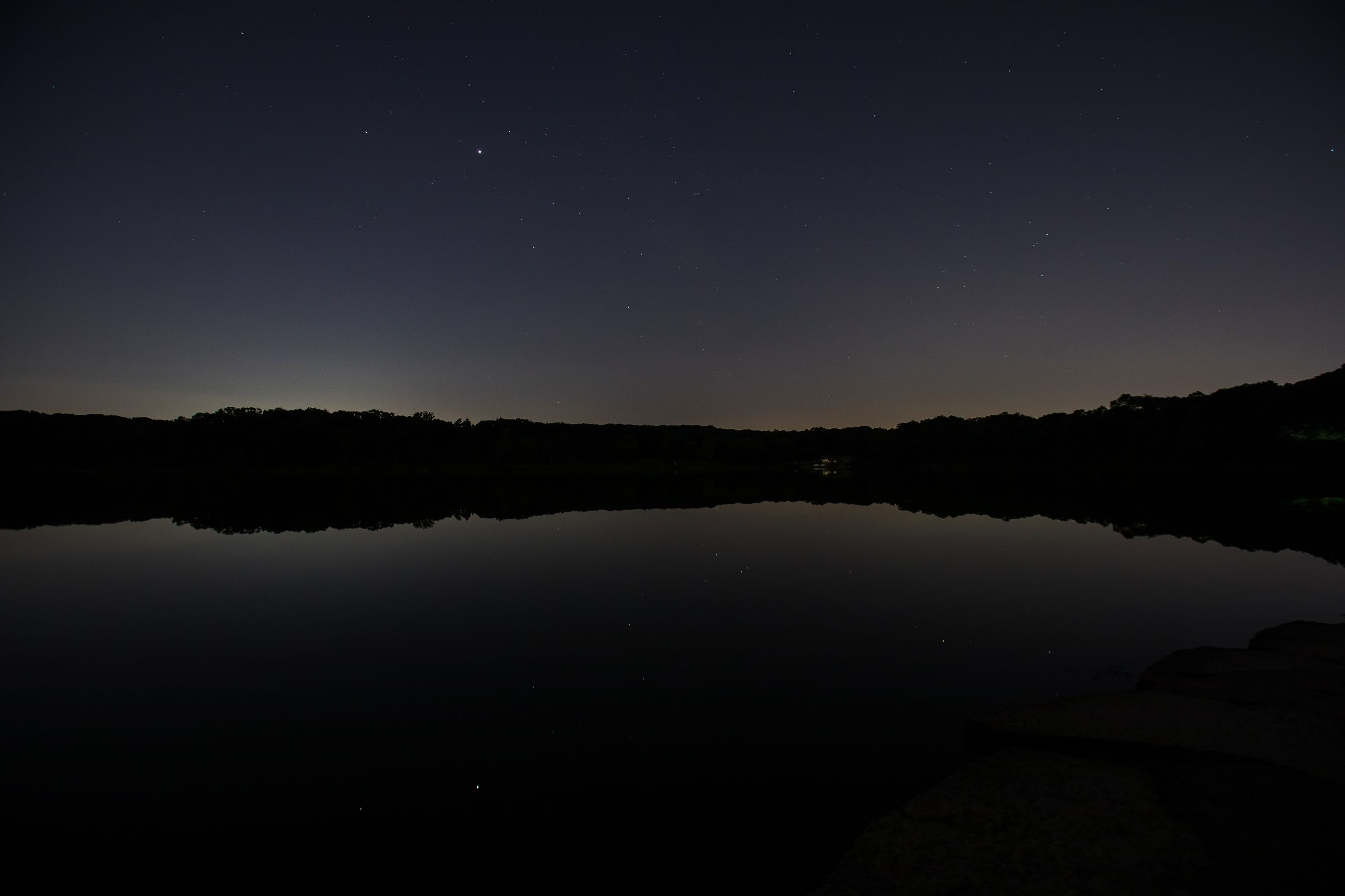 Image depicting the Urban Night Sky Place at night overlooking Maple Lake.